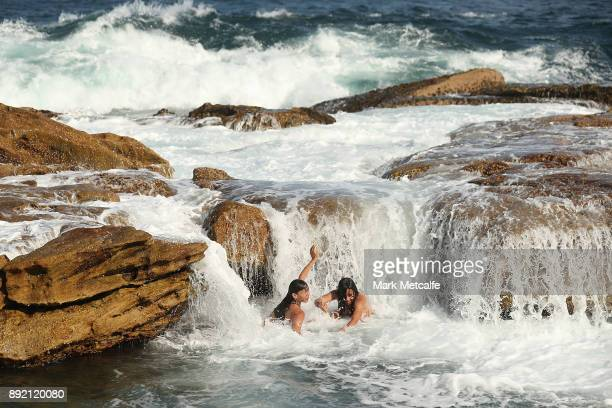 A wave crashes over children at a Coogee rock pool on December 14 2017 in Sydney Australia The bureau of meteorology has forecast temperatures over...