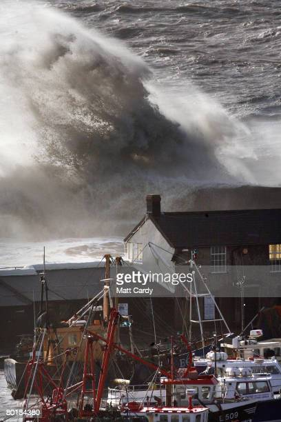 A wave crashes over the Cobb at high tide on March 10 2008 in Lyme Regis United Kingdom Weather forecasters are saying parts of the UK are being...