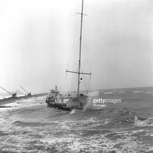 A wave crashing against the bows of the pirate music station Radio Caroline aground in rough waters between Frinton and HollandonSea where she blown...