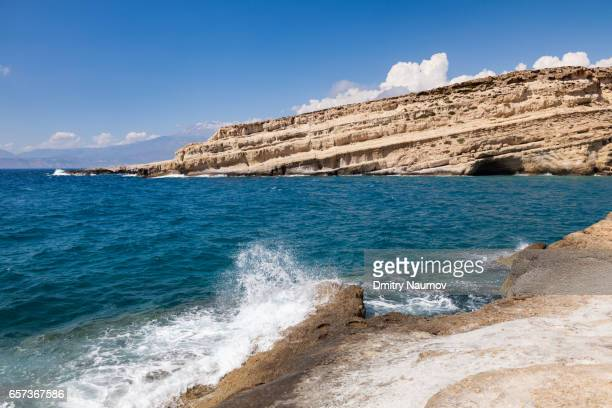 Wave crashing on rock at Matala beach, Heraklion, Crete,  Greece, Mediterranean