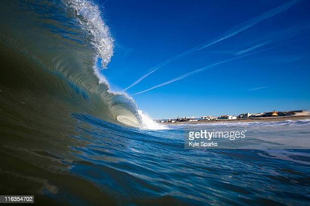 A wave gets hit back high tide backwash causing it to barrel in Oxnard, California.