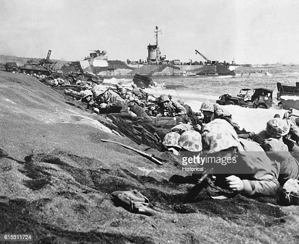 Wave of 4th Division Marines are pinned down by enemy fire as they begin an attack from the beach at Iwo Jima, Volcano Islands on February 19, 1945.