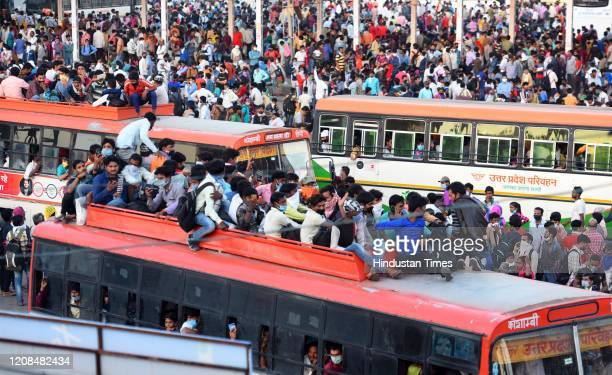 A wave of migrant workers seen at Anand Vihar Bus Terminus near the Delhi UP border following Uttar Pradesh government's call to arrange buses for...