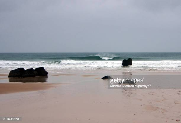 wave on the beach in durness - beach stock pictures, royalty-free photos & images