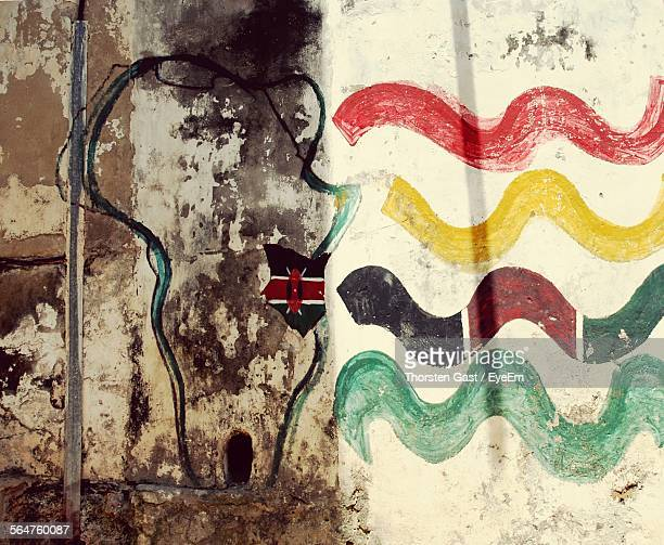 wave pattern on weathered wall - mombasa stock photos and pictures