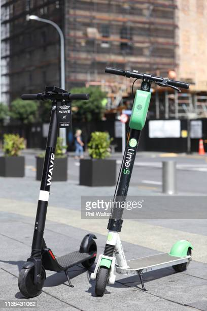 Wave scotter and a Lime scooter are pictured in the Auckland CBD on March 13 2019 in Auckland New Zealand Wave has entered the escooter trial in...