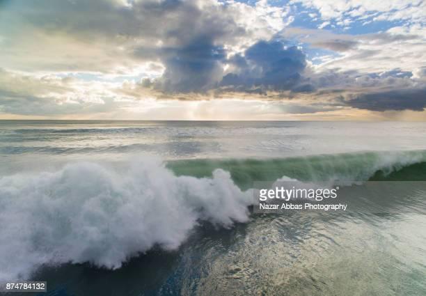 Wave splashing at Muriwai Beach, Auckland, New Zealand.