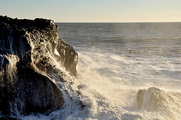 Wave Splashing on the rock at Dyrhólaey in southern Iceland
