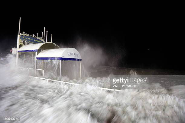 A wave spreads on the Promenade des Anglais in Nice southern France on January 23 2013 France's weather service Meteo France sounded an alert earlier...