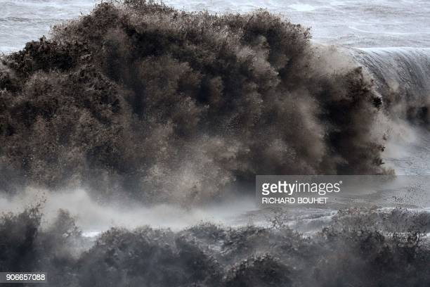 TOPSHOT A wave strong wave hits the shore in SaintJoseph on the French Indian Ocean island of La Reunion on January 18 as the tropical storm Beguitta...