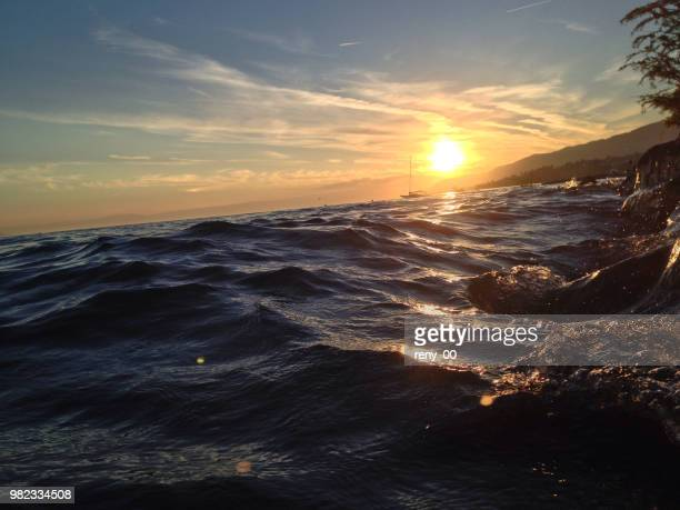 wave to the sun - utc−10:00 stock pictures, royalty-free photos & images