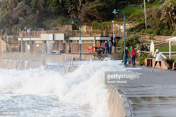 A wave washes over the damged pedestrian walkway at Bronte Beach on June 6 2016 in Sydney Australia Torrential rain over the weekend saw streets and...