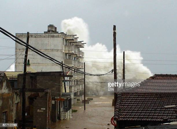 A wave with a height over the one of a fivestory building hits the waterfront in Baracoa eastern Cuba on the impending arrival of Hurricane Ike on...