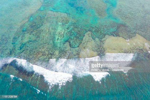 waves and coral reef from above, indian ocean, mauritius - atoll stock pictures, royalty-free photos & images
