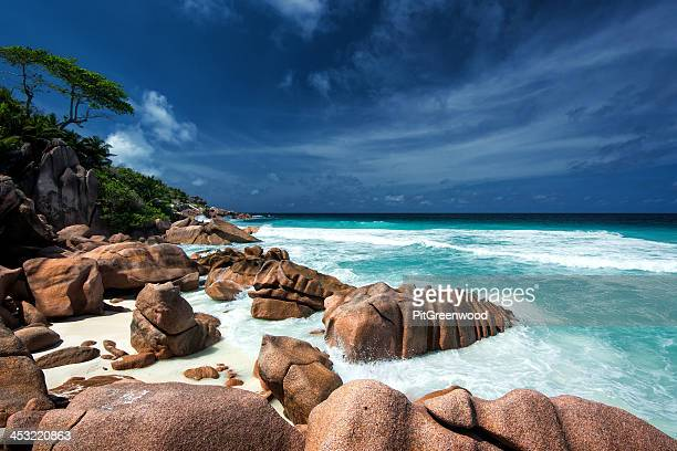 Waves and granite rocks on a paradise beach