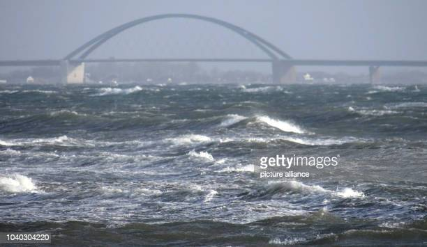 Waves are visible on the Baltic Sea at the Fehmarnsund Bridge close to Heiligenhafen Germany 09 January 2015 The storm front 'Elon' has reached...