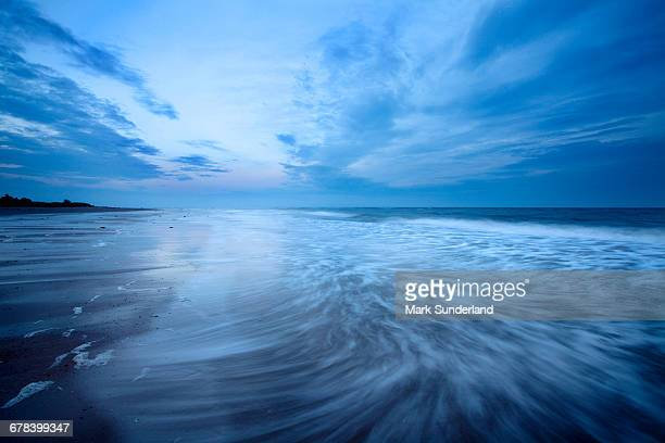 Waves at dusk on Alnmouth Beach, Northumberland, England, United Kingdom, Europe