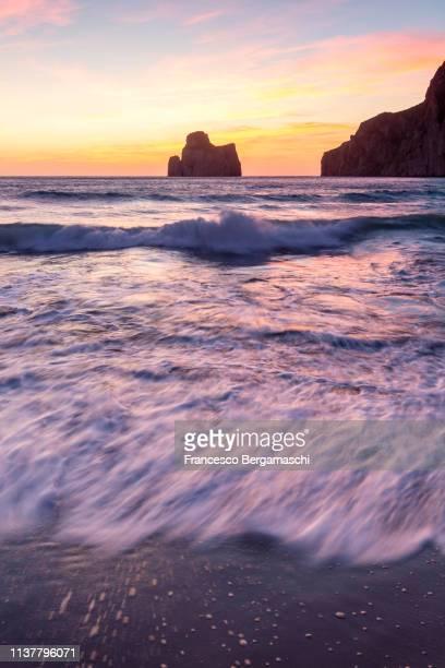 waves at sunset on the beach of masua, iglesias, sud sardegna province, sardinia, italy, europe. - italia ストックフォトと画像