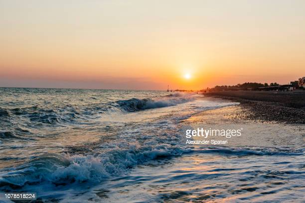 waves at the beach during sunset - belek stock pictures, royalty-free photos & images