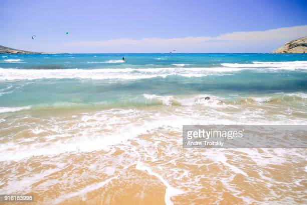 waves at the shore of mediterranean sea viewed from prasonisi beach, rhodes, greece - dodecanese islands stock photos and pictures