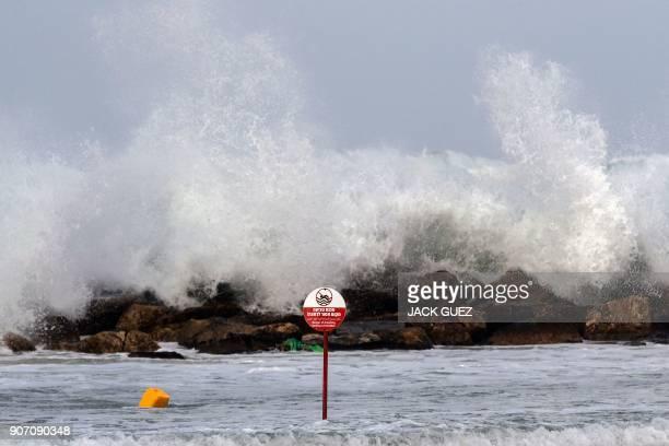 Waves break across the shore during a winter storm in the Israeli Mediterranean coastal town of Netanya north of Tel Aviv on January 19 2018 / AFP...