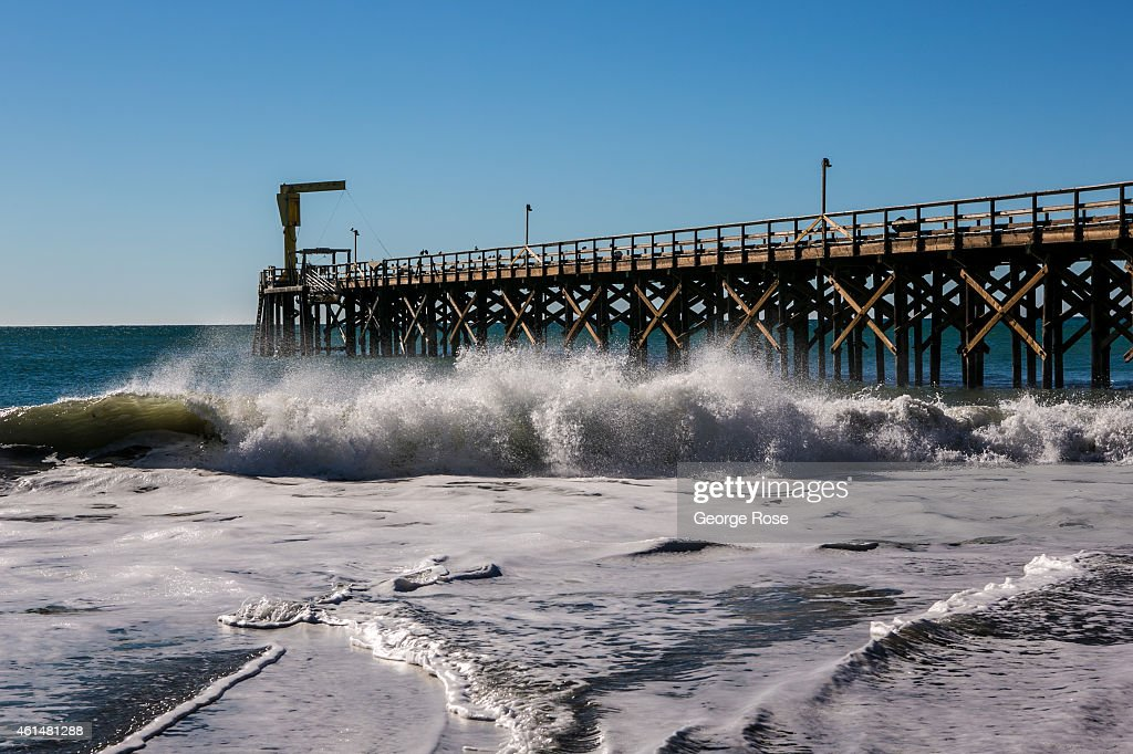 Waves break along the pier at Gaviota State Beach on December 24, 2014, in Santa Barbara, California. Because of its close proximity to Southern California and Los Angeles population centers, the coastal region of Santa Barbara has become a popular weekend getaway destination for millions of tourists.
