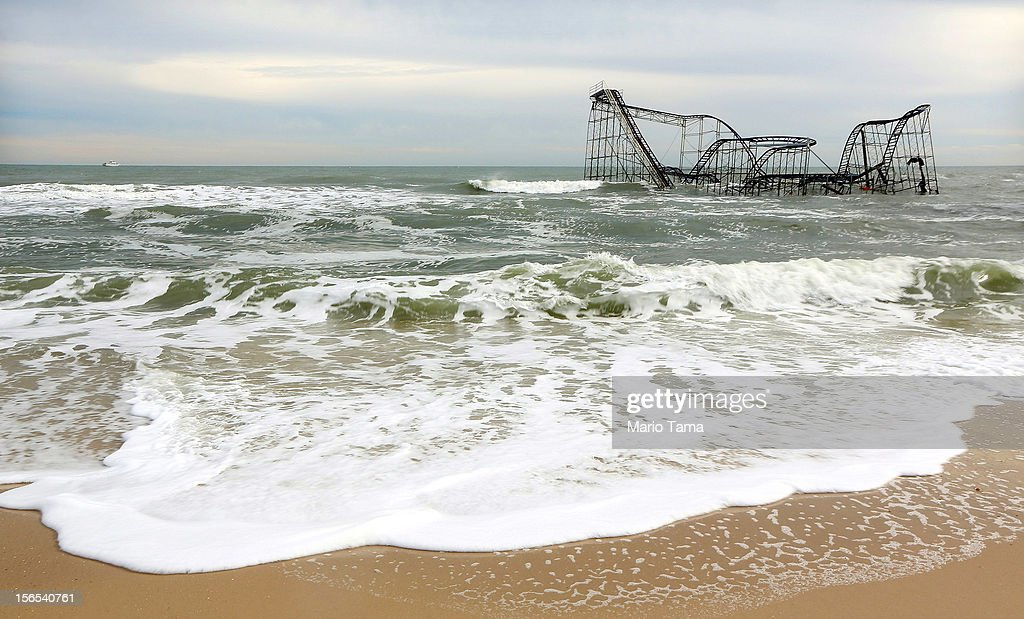 Waves break around a destroyed roller coaster on November 16, 2012 in Seaside Heights, New Jersey. Two amusement piers and a number of roller coasters in the seaside town were destroyed by Superstorm Sandy.