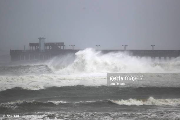 Waves break ashore near rthe Gulf State Park pier as the outer bands of Hurricane Sally come ashore on September 15, 2020 in Gulf Shores, Alabama....