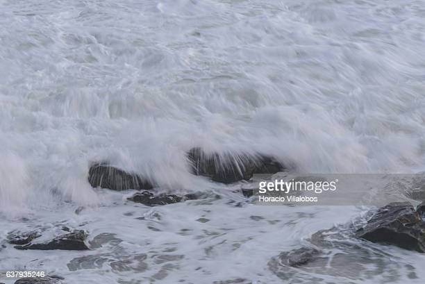 Waves break at Praia da Duquesa in stormy weather on January 03 2017 in Cascais Portugal