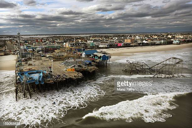 Waves break in front of a destroyed amusement park wrecked by Hurricane Sandy on October 31 2012 in Seaside Heights New Jersey At least 50 people...
