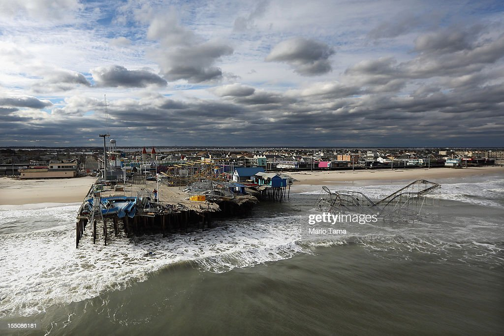 Waves break in front of a destroyed amusement park wrecked by Superstorm Sandy on October 31, 2012 in Seaside Heights, New Jersey. At least 50 people were reportedly killed in the U.S. by Sandy with New Jersey suffering massive damage and power outages.