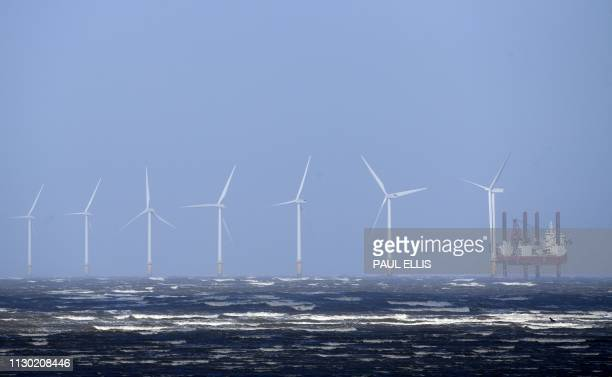 Waves break out at sea in front of Burbo Bank Offshore Wind Farm near New Brighton at the mouth of the river Mersey in northwest England on March 13...