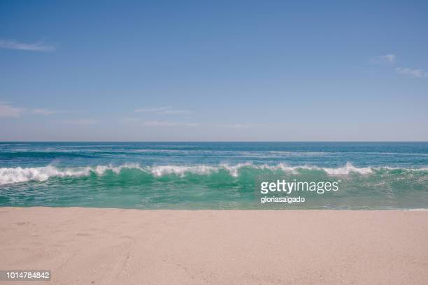 waves breaking on beach, australia - beach stock pictures, royalty-free photos & images