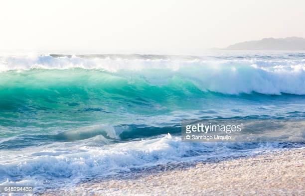 waves breaking on furnas beach - high key stock pictures, royalty-free photos & images