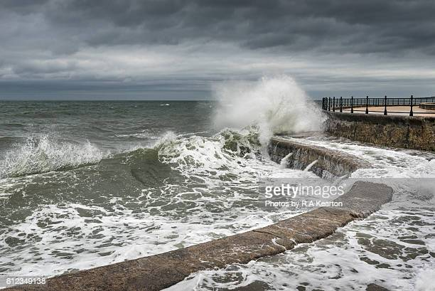 Waves breaking on the curve of a sea wall