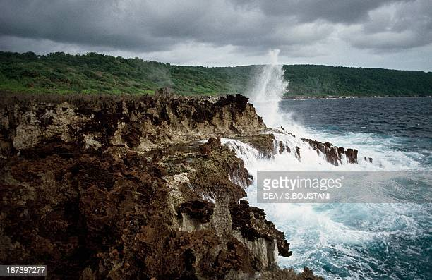 Waves breaking on the eroded volcanic cliffs at Christmas
