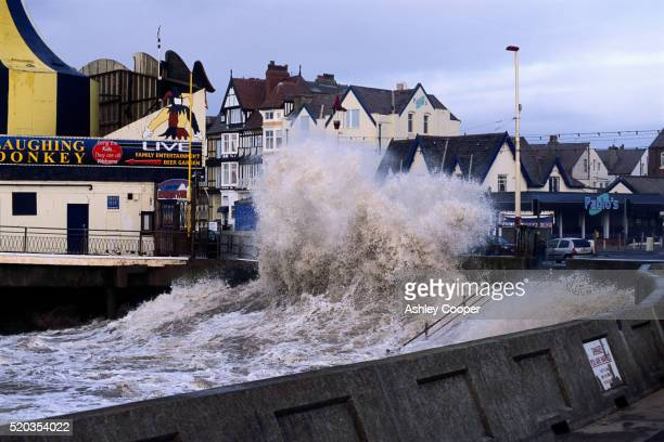 waves breaking over seawall during storm - seawall stock pictures, royalty-free photos & images