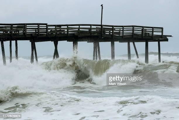Waves crach under the Avalon Pier that was damaged by Hurricane Dorian on September 6, 2019 in Kill Devil Hills, North Carolina. Dorian passed...