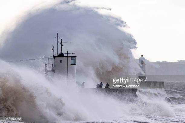 Waves crash agains the harbour wall on August 21 2020 in Porthcawl Wales The Met Office have issued a yellow weather warning for wind with gusts of...