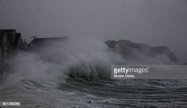 Waves crash against homes on Turner Road during blizzard conditions in Scituate Mass on January 04 2018