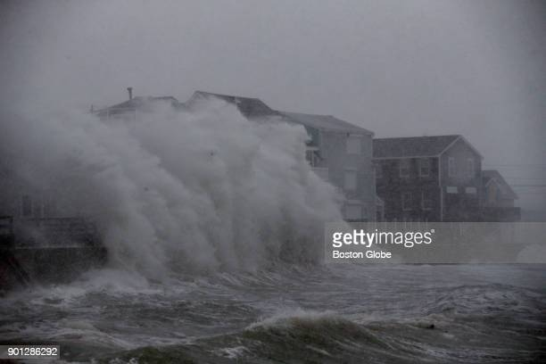 Waves crash against homes on Turner Road during blizzard conditions in Scituate Mass on Jan 04 2018