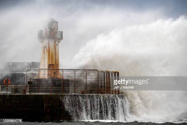 Waves crash against the harbour wall as Storm Ali hits land on September 19 2018 in ArdrossanScotland Severe gales which are set to get up to as much...