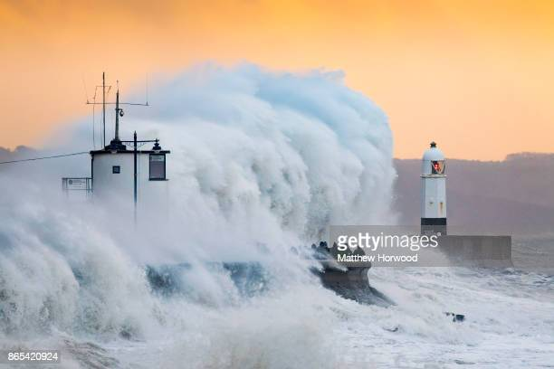 Waves crash against the harbour wall during Storm Brian on October 21 at Porthcawl, Wales. The Met Office have issued a yellow weather warning for...