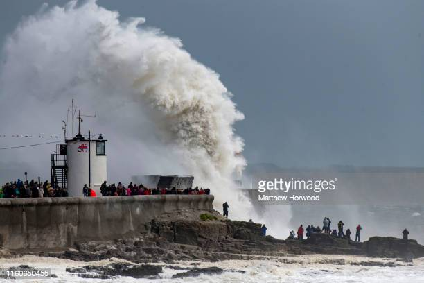 Waves crash against the harbour wall on August 10 2019 in Porthcawl Wales The Met Office have issued a yellow weather warnings for winds of up to...