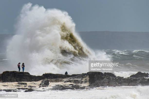 Waves crash against the harbour wall on August 10, 2019 in Porthcawl, Wales. The Met Office have issued a yellow weather warnings for winds of up to...