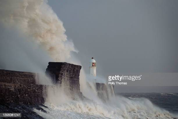 Waves crash against the harbour wall on February 09 2020 in Porthcawl United Kingdom Amber weather warnings are in place as gusts of up to 90mph and...