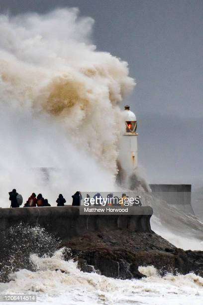 Waves crash against the harbour wall on February 15 2020 in Porthcawl United Kingdom The Met Office have issued an amber weather warning for rain in...