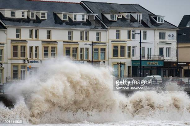 Waves crash against the harbour wall on February 15, 2020 in Porthcawl, United Kingdom. The Met Office have issued an amber weather warning for rain...