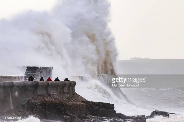 Waves crash against the harbour wall on October 4, 2019 in Porthcawl, Wales. The Met Office have issued a yellow weather warning for south-west...