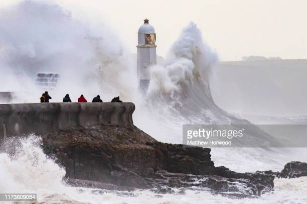 Waves crash against the harbour wall on October 4 2019 in Porthcawl Wales The Met Office have issued a yellow weather warning for southwest England...